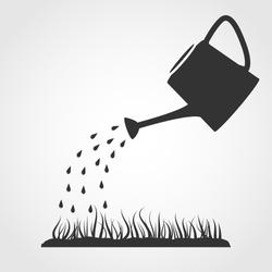 Dark grey watering can sprays water drops above lawn.