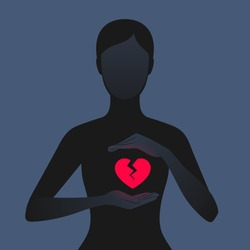 Dark silhouette of woman carefully holding hands near her red glowing broken heart. Unhappy relationships, betrayal, or the loss of beloved person. Concept of relations and breakup