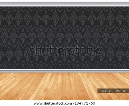 Dark wallpaper pattern wall with decorative white moldings, natural light wooden board floor