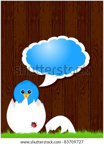 Dark wood background with green grass and blue bird from eggshell