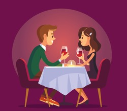 Dating. Valentines day celebration. Sweet happy young couple having romantic dinner with glasses of red wine on date.Drink wine.Christmas evening celebration.Pair couple together at  the dinner table.