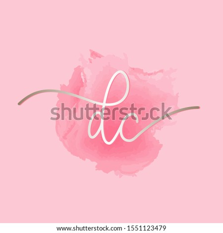 DC monogram logo.Signature style typographic icon with script letter d and letter c.Shiny metallic lettering sign isolated on pink watercolor fund.Calligraphic alphabet initials.Modern,elegant style.