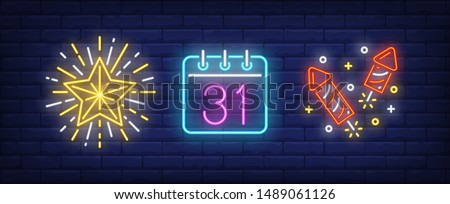 December thirty first on calendar and fireworks neon signs set. Christmas, New Year Day design. Night bright neon sign, colorful billboard, light banner. Vector illustration in neon style.