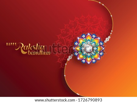 Decorated rakhi for Indian festival Raksha Bandhan Greeting Card ,indian festival  with gold patterned and crystals on paper color Background.