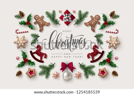 Decorative Frame made of Christmas Ornaments, Pine Branches, Snowflakes, Cookies and Holly. Flat lay, top view. #1254185539