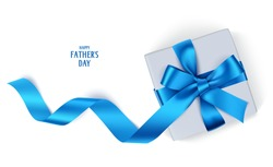 Decorative gift box with blue bow and long ribbon. Happy Father's Day text. Top view. Vector gift box isolated on white