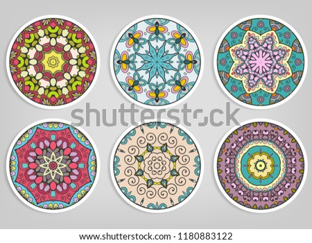 Decorative round ornaments set, isolated elements. Colorful mandala, stylized flower. Abstract geometric doodle patterns for plate decoration, fabric print,  business or greeting card design
