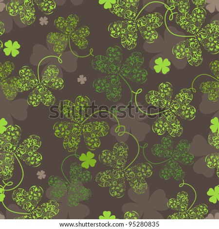 Decorative seamless background with green trefoil pattern.