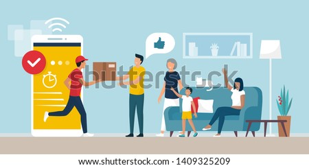 Delivery app service: man delivering a cardboard box to a happy cheerful family at home in the living room, logistics and technology concept