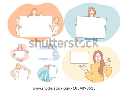 Demonstration, promotion, advertisement concept. Young positive cartoon characters holding and pointing with fingers at white blank placard with copy space for text and advertising isolated over white