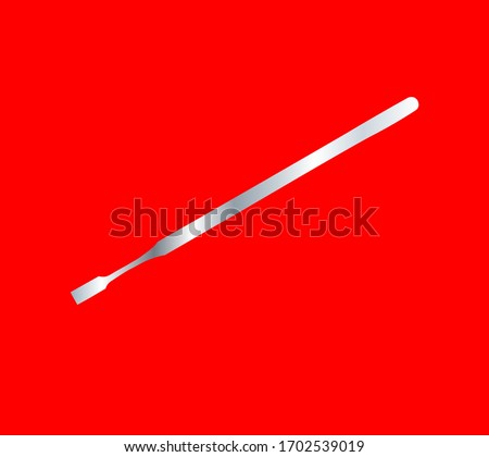 Dental chisel on a red background