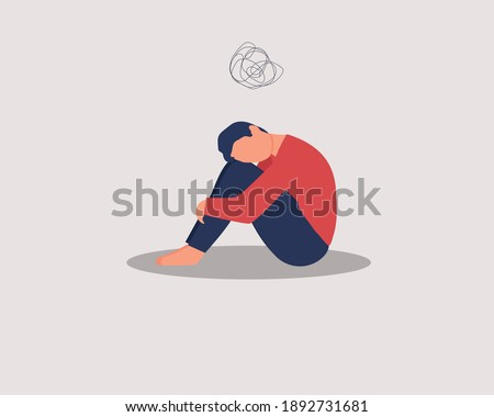 Depressed male character sitting on floor and hugging knees, above  scribble. Mental health concept. Depression, bipolar disorder, dementia, obsessive compulsive, post traumatic stress disorder. Stock photo ©