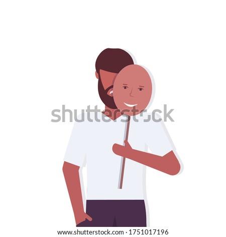 depressed man holding positive