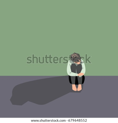 Depressed man sit and  hugging his knees.Concept of sad people