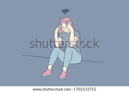 Depression, fatigue, mental stress, frustration concept. Young depression frustrated woman or girl teenager sitting on floor at home. Fatigue, raising of mental stress because of headache or bad news.