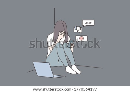 Depression, frustration, mental stress, media concept. Young derpessed frustrated woman girl teenager sitting on floor with smartphone reading messages. Suffering from cyberbullying in social network.