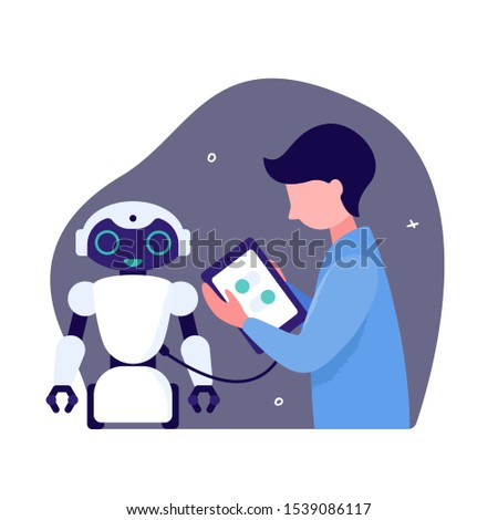 Design of robots and robotic systems. The guy loads the software in the android robot. Autonomous robot on wheels and a man holding a tablet in his hands