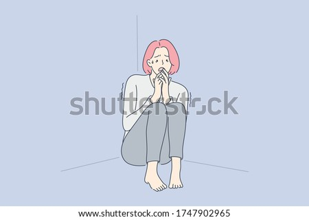 Despair, frustration, fear, mental stress concept. Young terrified scared girl or woman cartoon character sitting in corner and shaking from fear. Family violence problem or psychological phobia.