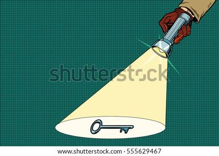 Detective flashlight beam shines on key. Pop art retro vector illustration