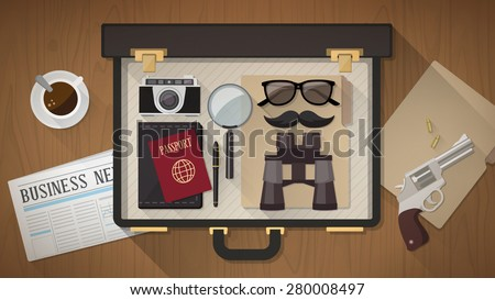 Detective vintage briefcase with camera, magnifier, sunglasses, passport, mustaches, revolver and newspaper on a desktop, top view