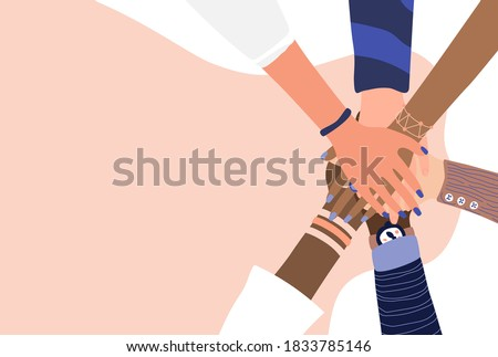 Different people join hands in a fit of teamwork. A group of people strives for a common goal in their work. Together strength, confidence and result. Friendship and helping each other in unity. Stockfoto ©