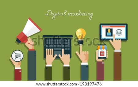 Digital marketing concept.  Human hand with a megaphone, laptop, mobile, tablet, lightbulb, Baskets