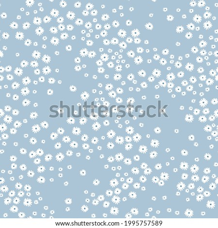 Ditsies floral pattern. Pretty flowers on light blue background. Printing with small white flowers. Ditsy print. Seamless vector texture. Spring bouquet.