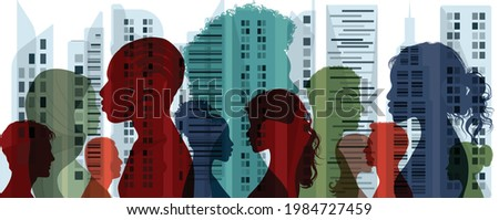 Diverse multiethnic and multicultural people.Concept of society and diversity.Integration coexistence and harmony of peoples.Population of diverse culture.City and Buildings background