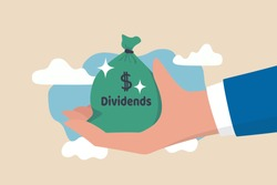 Dividend stocks, public company payback profit in stock market, return or profit from investment concept, businessman investor hand holding big money bag with label Dividends and dollar money sign.
