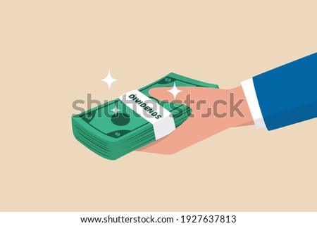 Dividends stock payment, passive income from dividend yield concept, rich and wealthy businessman hand holding pile of dollar money banknotes with the word Dividends. Photo stock ©