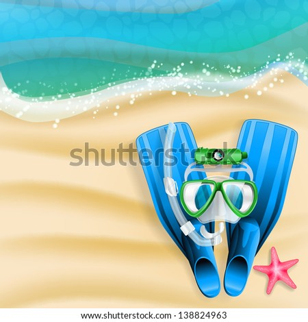 diving mask, cam, tube and starfish on beach background