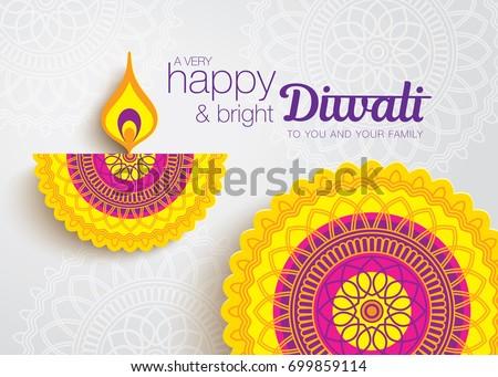 Diwali festival greeting card with beautiful rangoli and diya background