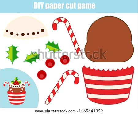 DIY children educational creative tutorial game. Paper cutting activity. Make a New Year, Christmas cupcake with glue and scissors #1165641352