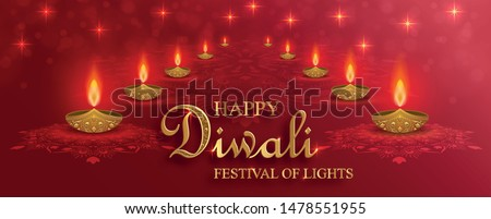Diya lamp with fire lighting for Diwali, Deepavali or Dipavali, the indian festival of lights on color background
