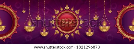 Diya lamp with fire lighting for Diwali, Deepavali or Dipavali, the indian festival of lights on color background Stock photo ©