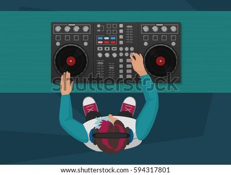 DJ playing vinyl. Top view. DJ Interface workspace mixer console turntables. Night club concept. DJ young man