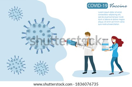 Doctor holding covid-19 vaccination syringe and vaccine vial fighting with coronavirus. Idea for medical team effort and world hope for COVID-19 vaccine to save mankind lives.