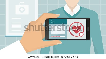 Doctor visiting a patient at the hospital, he is using an augmented reality app and monitoring heartbeat, healthcare and technology concept