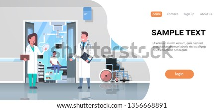 doctors couple discussing in hospital corridor with wheelchair open door to surgery room african man sitting operating table modern clinic interior flat full length horizontal copy space