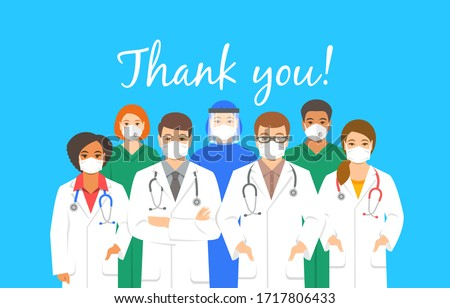 Doctors team in protective face masks with thank you inscription. Appreciation for hospital staff fighting the spread of coronavirus. Personnel of medical clinic, physicians and nurses stand together