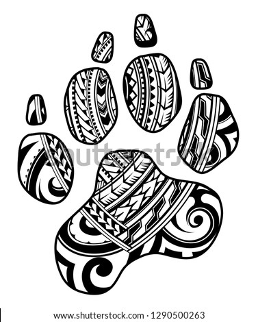 Dog paw as a tattoo with tribal style pattern inside