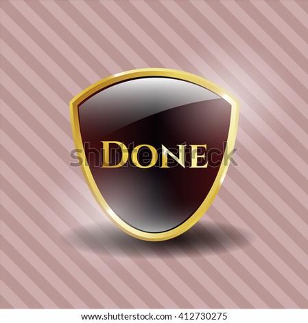 Done gold emblem or badge