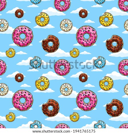 Donuts with pink glaze and colored sprinkles  on blue sky background.  Seamless pattern. Texture for fabric, wrapping, wallpaper. Decorative print.