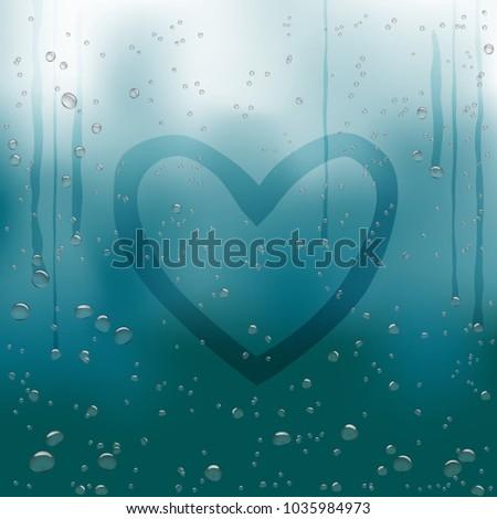 drawn heart on rainy window