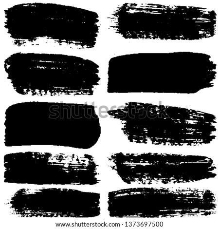 Dry brush strokes. Abstract vector strokes and spots. Set of black blots and lines isolated on white background
