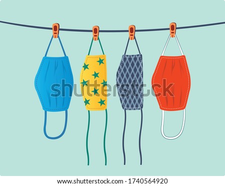 Dry cloth face masks illustration. Drying fabric masks. Hang reusable masks and air-dry under indirect sunlight. Hanging washable mask vector. Foto d'archivio ©