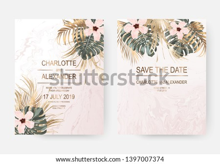 Dry gold tropical palm leaves and hibiscus flowers frames for wedding design on pink marble background.