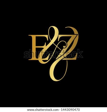 E & Z / EZ logo initial vector mark. Initial letter E & Z EZ luxury art vector mark logo, gold color on black background. Zdjęcia stock ©