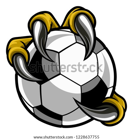 Eagle, bird or monster claw or talons holding a soccer football ball. Sports graphic. Photo stock ©