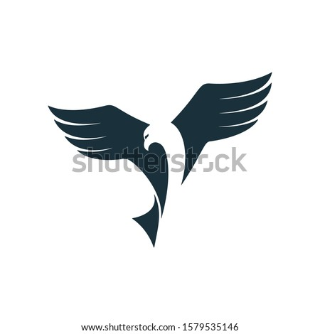 eagle gliding through sky and